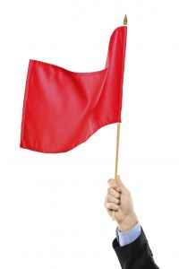 Hand waving a red flag